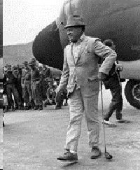 Bob Hope arriving in Vietnam with his signature golf club.